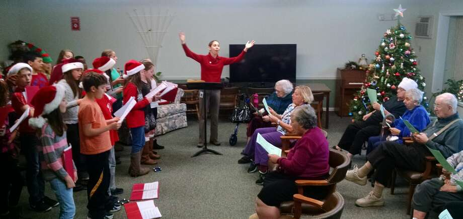 Students from the Squadron Line School Chorus performed on December 18th at a concert hosted by the residents of Belden Forest Court in Simsbury. Every year, the active residents make the season merry for local school children and community groups.