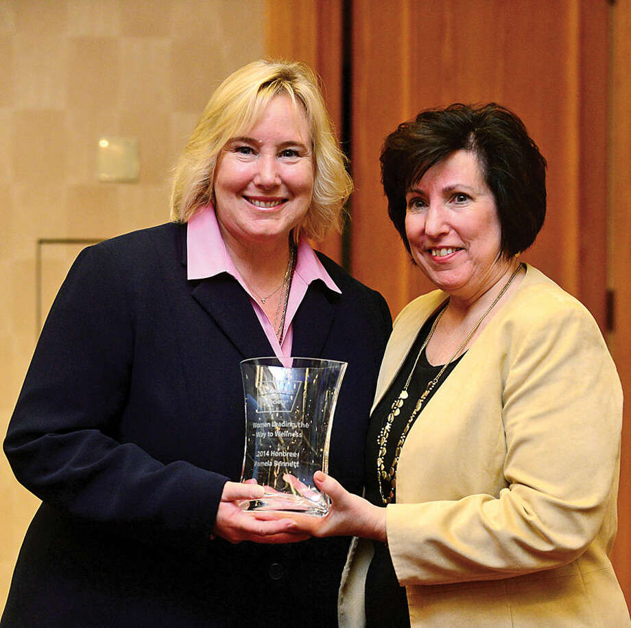"Hour photo / Erik Trautmann American Cancer Society Executive Vice President Peg Camp honors Executive Director of Patient and Professional Relations at Purdue Pharma L.P., Pamela Bennett, RN, BSN, CCE; as The American Cancer Society hosts the inaugural ""Women Leading the Way to Wellness Breakfast"" Wednesday morning at Dolce Norwalk. Fairfield county residents, local business and community leaders, and health professionals gathered to learn more about cancer prevention and early detection."