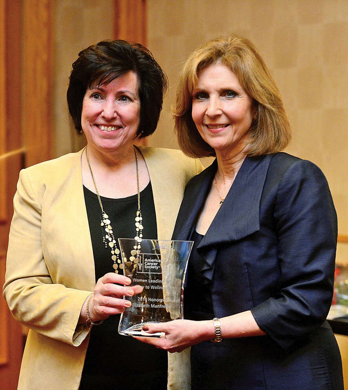 Hour photo / Erik Trautmann American Cancer Society Executive Vice President Peg Camp honors Director of Cancer Services at Stamford Hospital's Carl & Dorothy Bennett Cancer Center, Elizabeth Manfredo, MS, RD, as The American Cancer Society hosts the inaugural