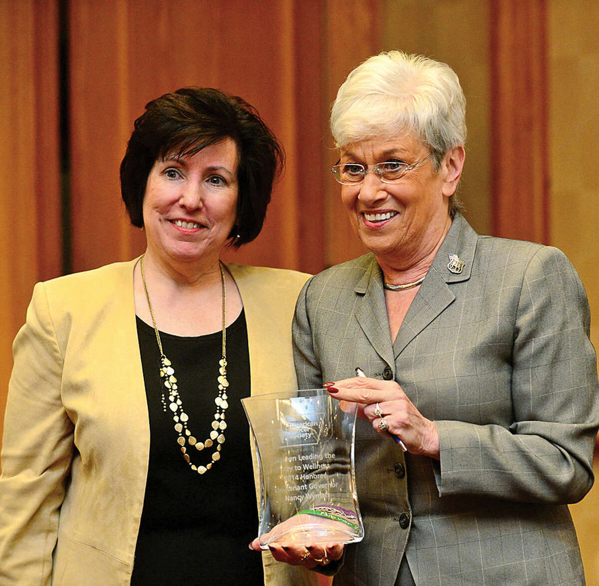 Hour photo / Erik Trautmann American Cancer Society Executive Vice President Peg Camp honors Lieutenant Governor Nancy Wyman as The American Cancer Society hosts the inaugural