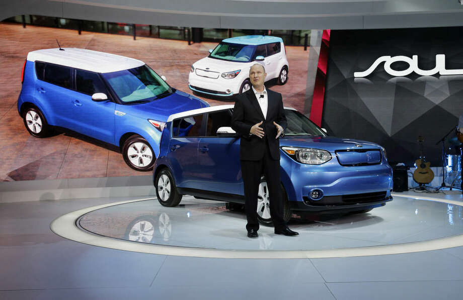 FILE- In this Feb. 6, 2014, file photo, Orth Hedrick, vice president of product planning at Kia, introduces the 2015 Soul EV during the media preview of the Chicago Auto Show at McCormick Place in Chicago. (AP photo/Nam Y. Huh, File)