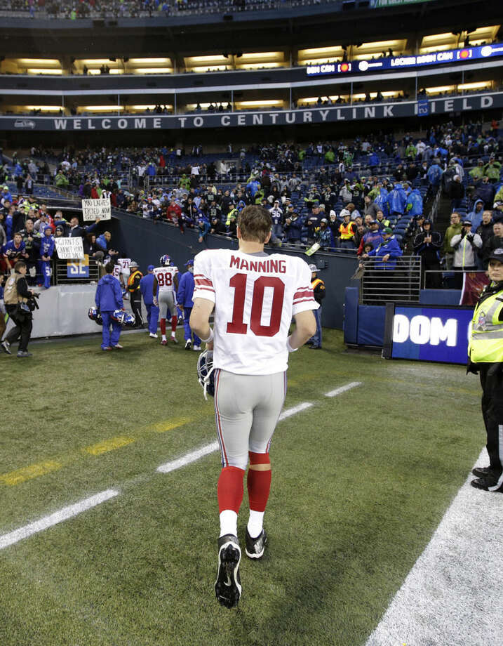 New York Giants quarterback Eli Manning leaves CenturyLink Field after the Seattle Seahawks defeated the Giants 38-17 in an NFL football game, Sunday, Nov. 9, 2014, in Seattle. (AP Photo/Scott Eklund)