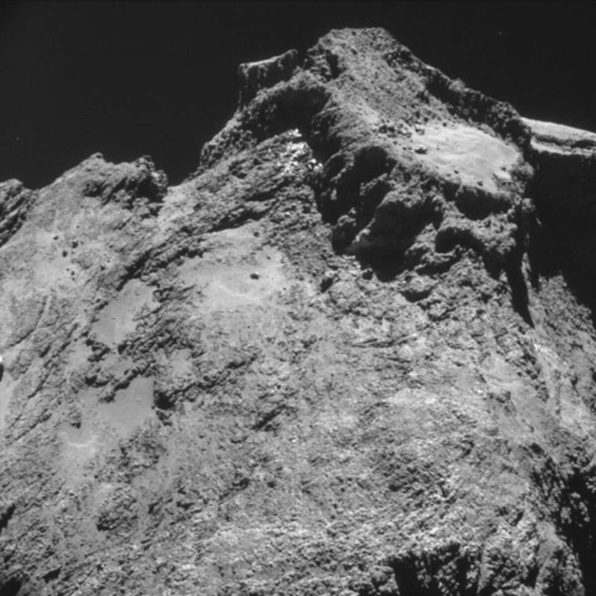 The picture taken with the navigation camera on Rosetta and released by the European Space Agency ESA shows a raised plateau on the larger lobe of Comet 67P/Churyumov-Gerasimenko. It was captured from a distance of 9.8 km from the center of the comet (7.8 km / 4.8 miles from the surface) Oct. 24, 2014. On Wednesday, Nov. 12, 2014 the Philae lander will be detached from Rosetta to land on the comet. (AP Photo/ESA)