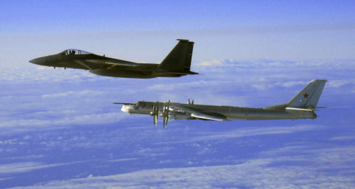 FILE - This Thursday, Sept. 28, 2006 file photo provided by the U.S. Air Force shows an F-15C Eagle from the 12th Fighter Squadron at Elmendorf Air Force Base in Anchorage, Alaska, flying next to a Russian Tu-95