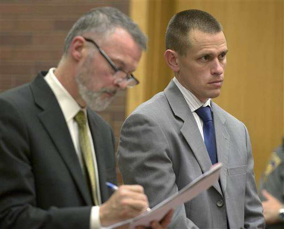 Kyle Seitz, right, of Ridgefield, stands for arraignment with his attorney John Gulash, left, in Danbury Superior Court Wednesday, Nov. 12, 2014, in Danbury. Seitz was charged in the death of his 15-month old son, Benjamin, who died after being left in a hot car for more than seven hours on July 7.