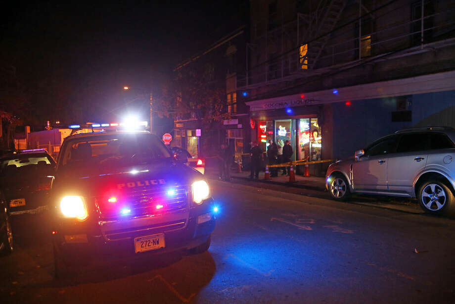 Police check out the scene of a stabbing at Cocchia Liquor on Ely Avenue Wednesday evening. Hour Photo / Danielle Calloway