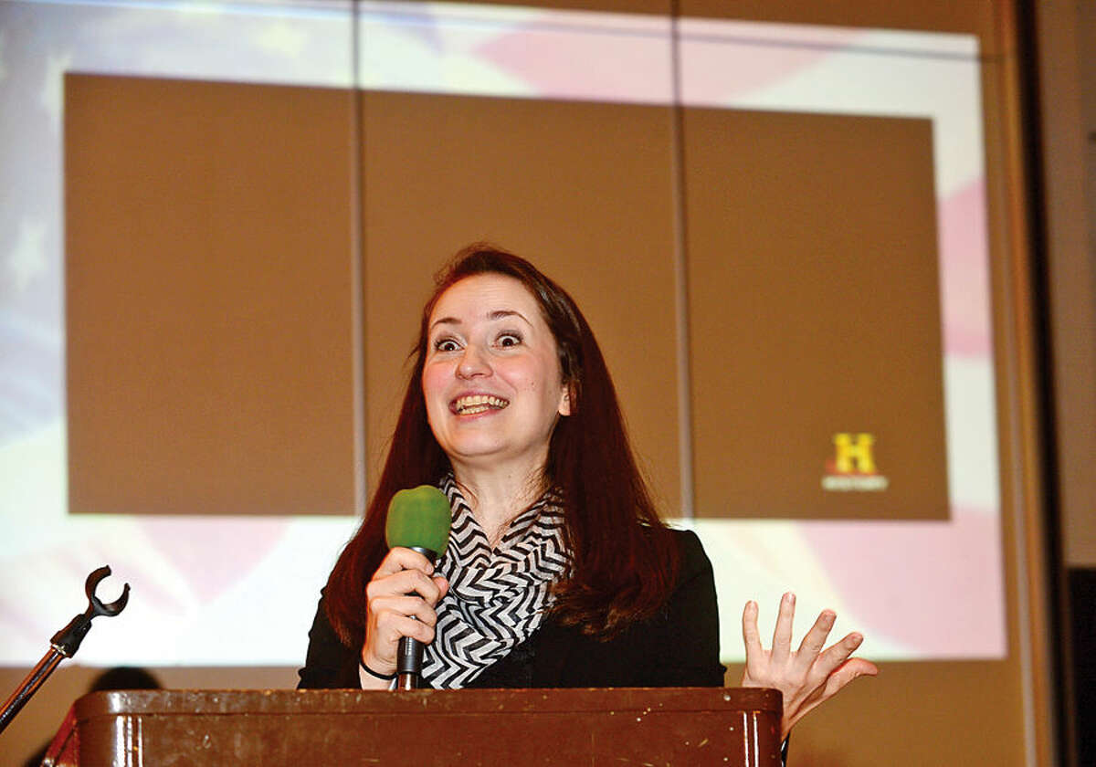 Hour photo / Erik Trautmann The History Channel's Kirsten Young speaks about their program, Take a Veteran to School Day, during a Veteran's Day ceremony at Cider Mill Elementary School in Wilton Tuesday.