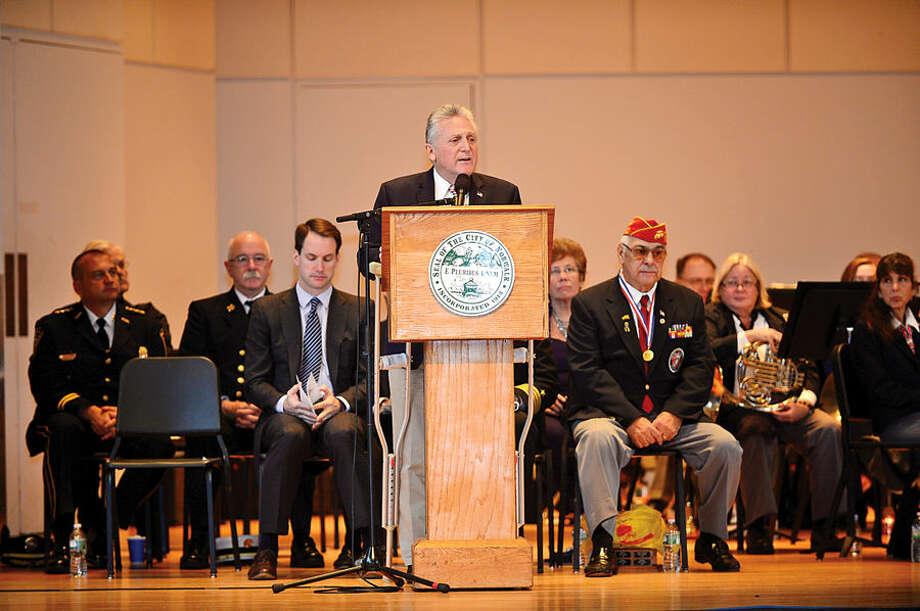 Hour photo / Erik Trautmann Norwalk mayor Harry Rilling speaks during the Norwalk Veteran's Day celebration at City Hall Tuesday morning.