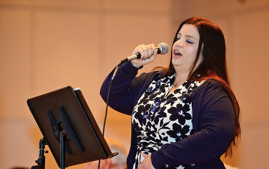 "Hour photo / Erik Trautmann Alison Faye sings ""The Battle Hym of the Republic"" during the Norwalk Veteran's Day celebration at City Hall Tuesday morning."