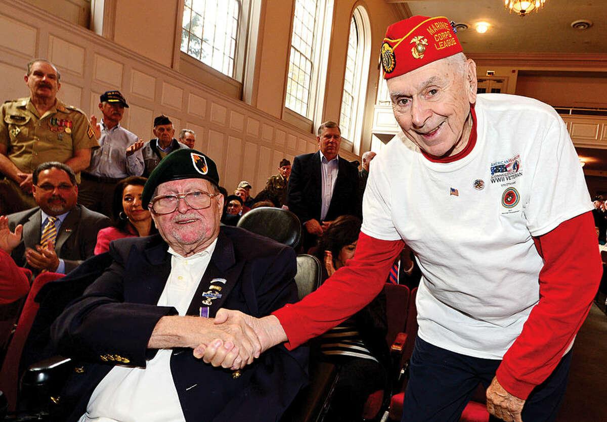 Hour photo / Erik Trautmann Army veteran David Cole and Marine Corp vetran Vito Ottaviano share a moment during the Norwalk Veteran's Day celebration at City Hall Tuesday morning.
