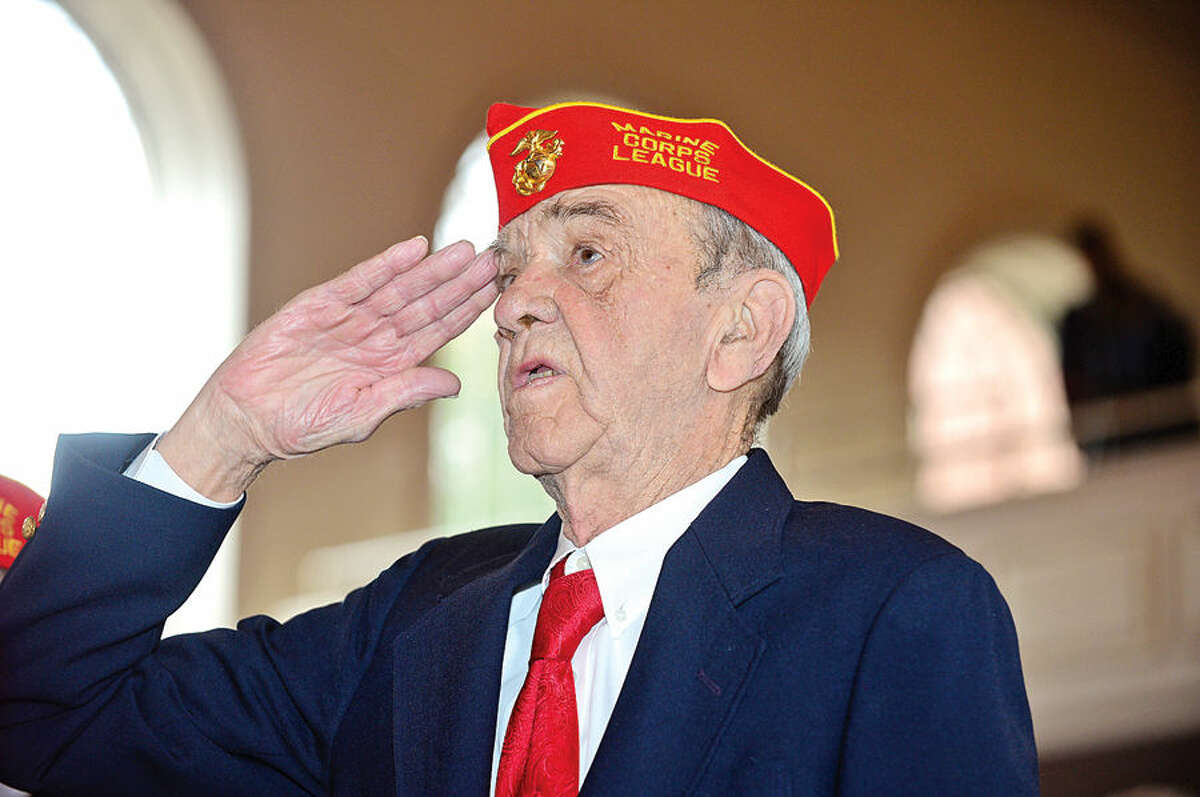 Hour photo / Erik Trautmann Marine Corps veteran Lee Seymore sings the National Anthem during the Norwalk Veteran's Day celebration at City Hall Tuesday morning.