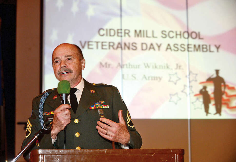 Hour photo / Erik Trautmann Viet Nam Army veteran Sgt. Arthur Wiknik gives his address during a Veteran's Day ceremony at Cider Mill Elementary School in Wilton Tuesday.