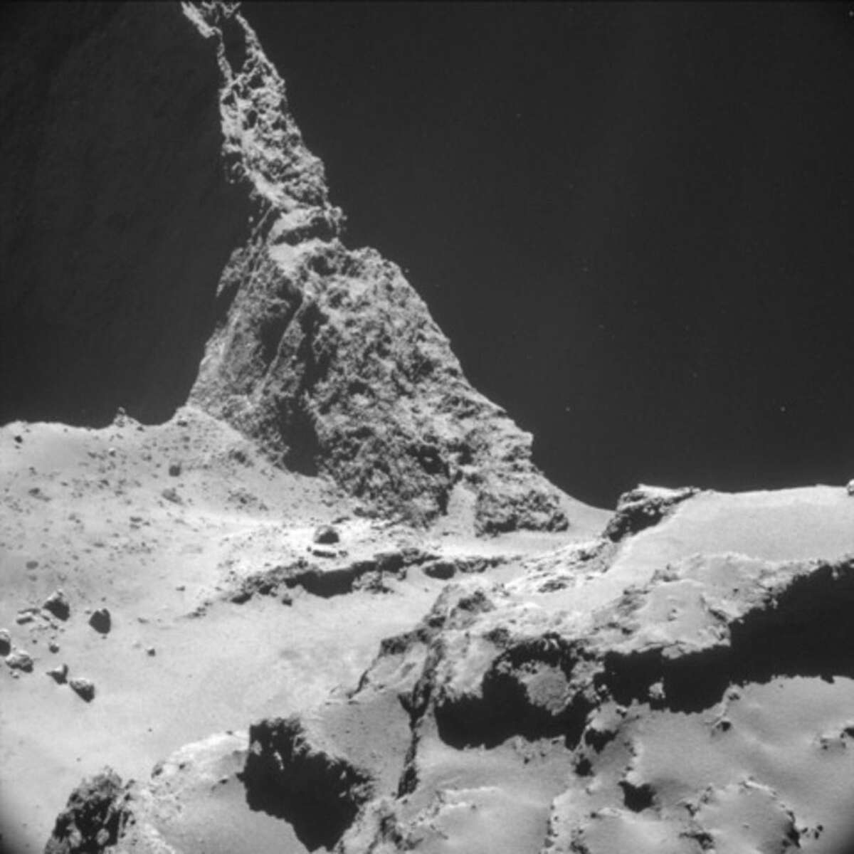 The picture taken with the navigation camera on Rosetta and released by the European Space Agency ESA shows the boulder-strewn neck region of Comet 67P/Churyumov-Gerasimenko, with the smaller lobe on the left and the larger lobe on the right. It was captured from a distance of 9.7 km from the center of the comet (about 7.7 km / 4.8 miles) from the surface) on Oct. 28, 2014. On Wednesday, Nov. 12, 2014 the Philae lander will be detached from Rosetta to land on the comet. (AP Photo/ESA)