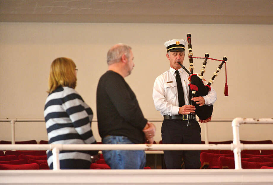 Hour photo / Erik Trautmann Norwalk Fire Department Deputy Fire Chief Ed Prescott plays Amazing Grace during Norwalk Veteran's Day celebration at City Hall Tuesday morning.