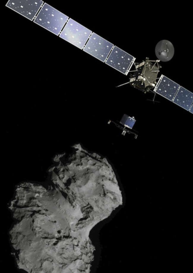 The picture released by the European Space Agency ESA shows the Rosetta mission poster which is a combination of various images to illustrate the deployment of the Philae lander to comet 67P/Churyumov-Gerasimenko. from the Rosetta spacecraft. The image of the comet was taken with the navigation camera on Rosetta. On Wednesday, Nov. 12, 2014 the Philae lander will be detached from Rosetta to land on the comet. (AP Photo/ESA)