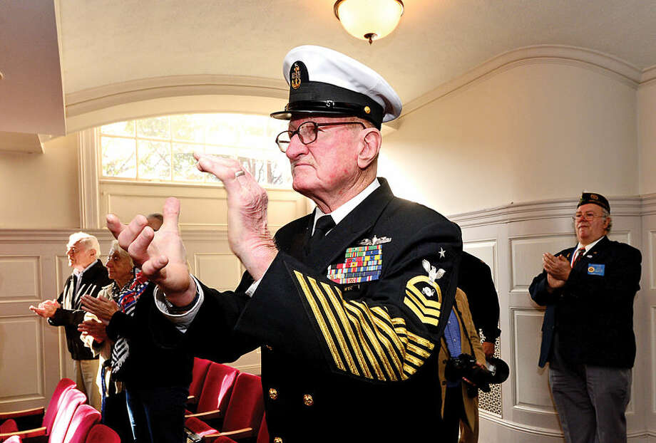 Hour photo / Erik Trautmann Navy Veteran Don Burrows applauds during the Norwalk Veteran's Day celebration at City Hall Tuesday morning.
