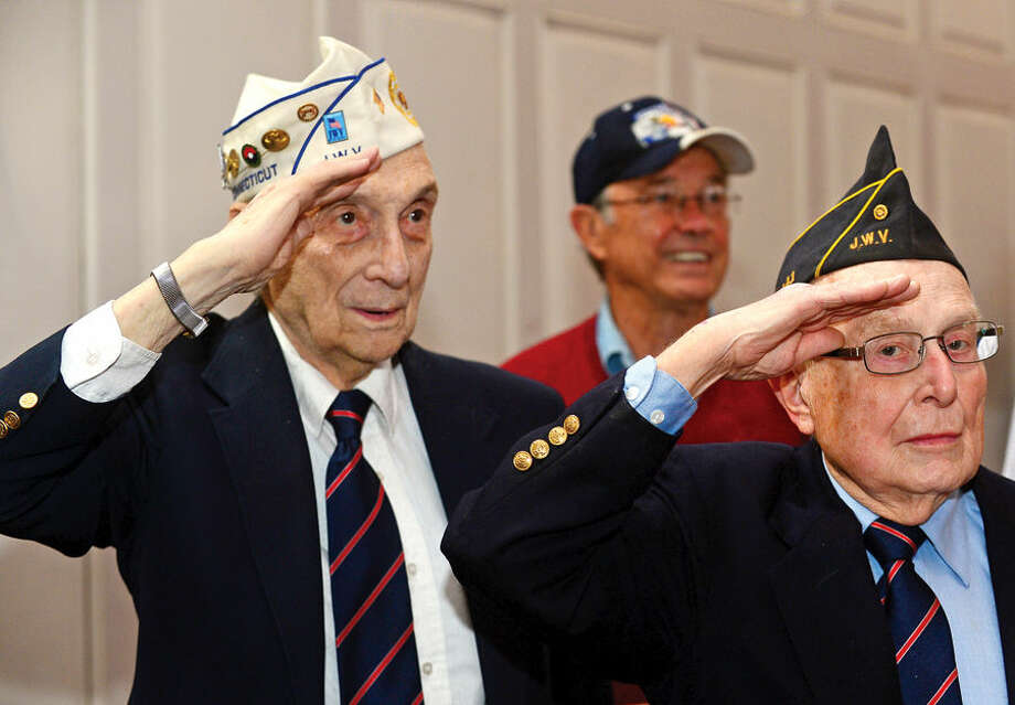Hour photo / Erik Trautmann Norwalk vetarans attend the Norwalk Veteran's Day celebration at City Hall Tuesday morning.