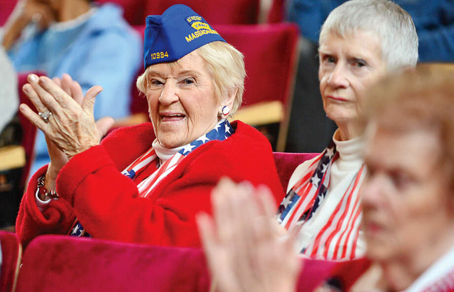 Hour photo / Erik Trautmann The Ladies Auxiliary shows their support for veterans during the Norwalk Veteran's Day celebration at City Hall Tuesday morning.