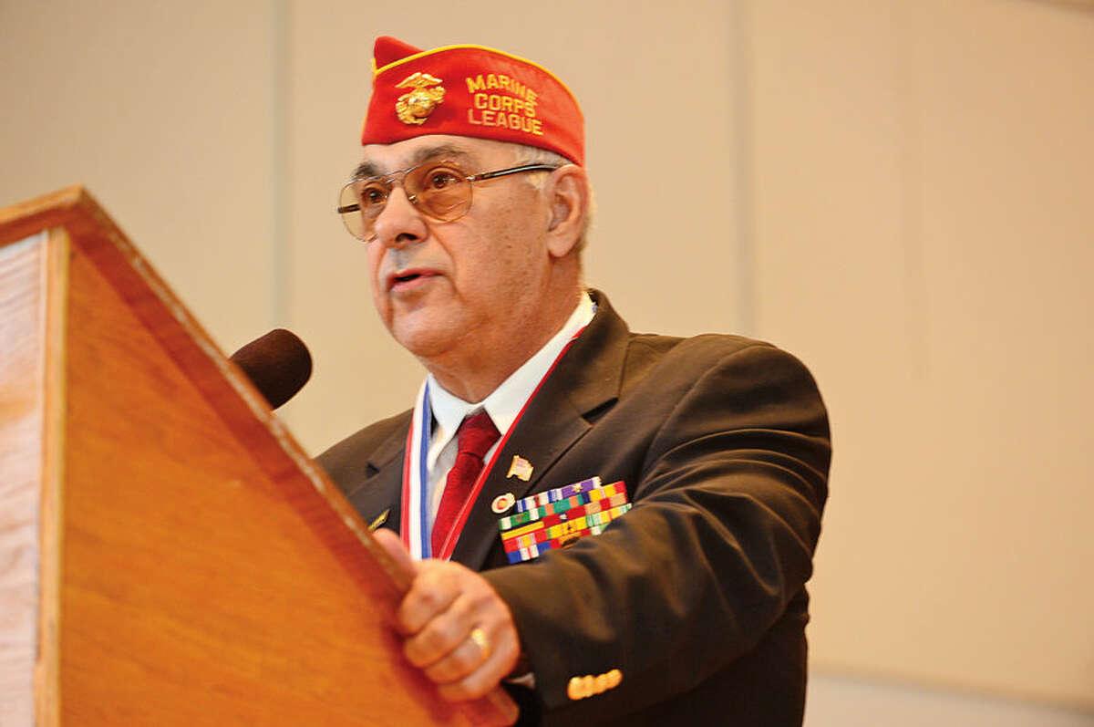 Hour photo / Erik Trautmann Norwalk Veterans Memorial Committee chair Dan Caporale speaks during Norwalk Veteran's Day celebration at City Hall Tuesday morning.