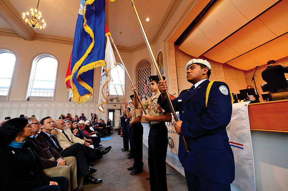 Hour photo / Erik Trautmann Norwalk ROTC cadets display the colors of the various branches of service during Norwalk Veteran's Day celebration at City Hall Tuesday morning.