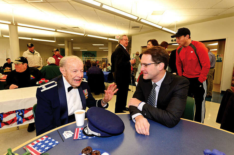 Hour photo / Erik Trautmann US Congressman Jim Himes, right, chats with Air Force veteran Col. Jack Daniels following a Veteran's Day assembly at Cider Mill Elementary School in Wilton Tuesday.