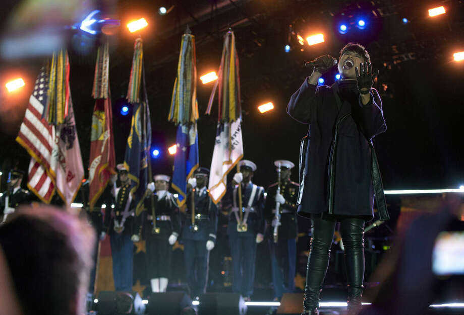 Jennifer Hudson sings the National Anthem on the National Mall in Washington, Tuesday, Nov. 11, 2014, during the Concert for Valor. The Veterans Day event is hosted by HBO, Starbucks and Chase and is free and open to the public. (AP Photo/Carolyn Kaster)