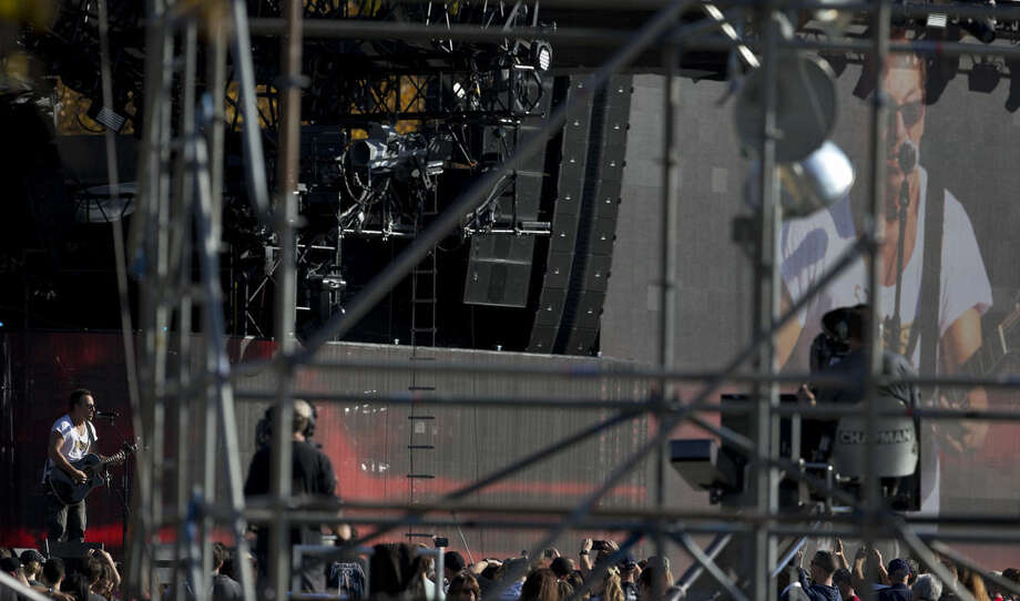 Bruce Springsteen sings during a sound check on the National Mall in Washington, Tuesday, Nov. 11, 2014, before the Concert for Valor. The Veterans Day event is hosted by HBO, Starbucks and Chase and is free and open to the public. (AP Photo/Carolyn Kaster)