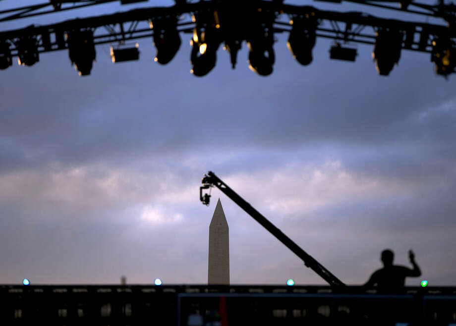 The Washington Monument is photographed through the stage on the National Mall in Washington, Tuesday, Nov. 11, 2014, before the start of the Concert for Valor. The Veterans Day event is hosted by HBO, Starbucks and Chase and is free and open to the public. (AP Photo/Carolyn Kaster)