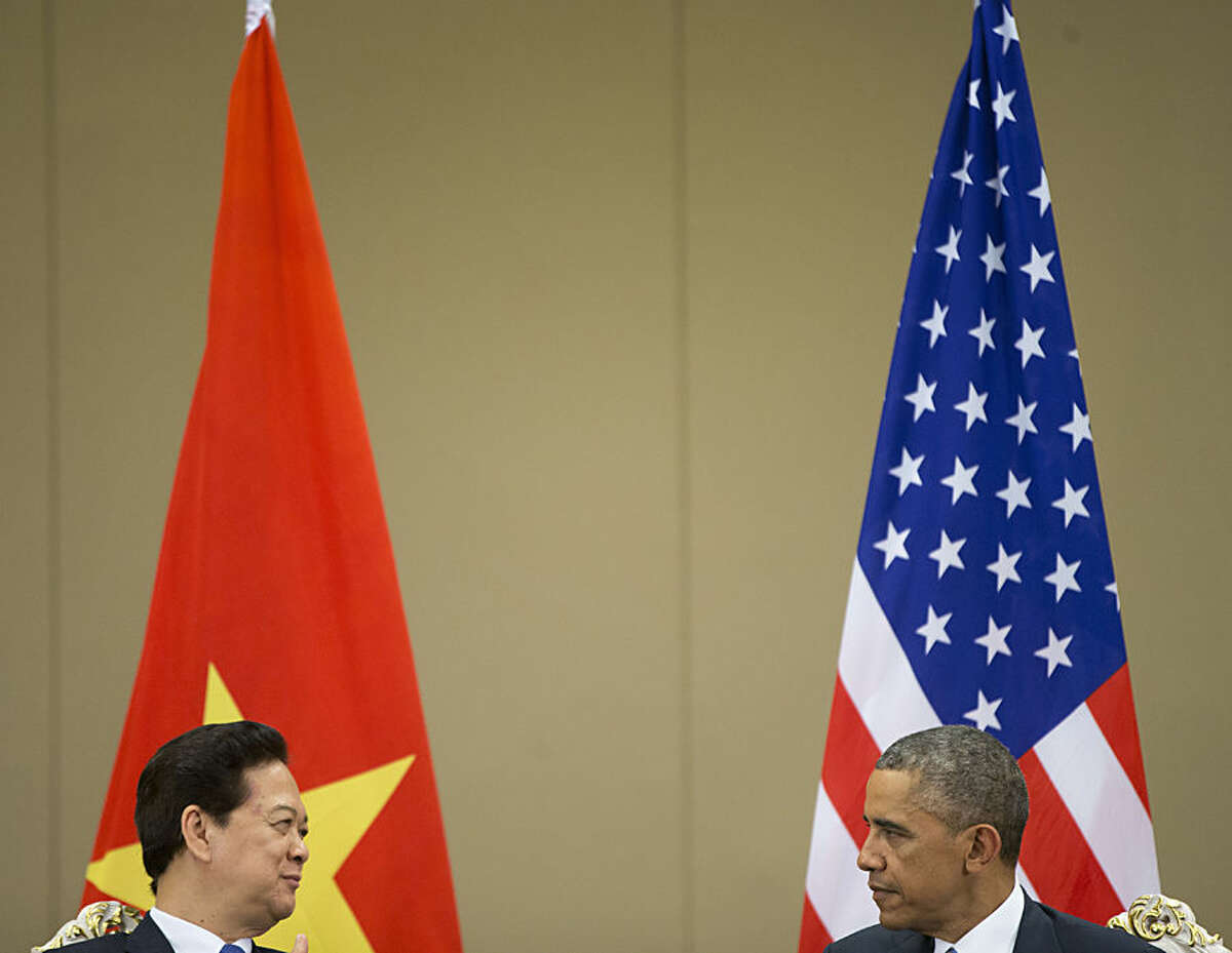 U.S. President Barack Obama, right, and Vietnamese Prime Minister Nguyen Tan Dung attend their bilateral meeting held on the sidelines of the Association of Southeast Asian Nations summit at the Myanmar International Convention Center, Thursday, Nov. 13, 2014 in Naypyitaw, Myanmar. Obama says he sees opportunities for deeper engagement and cooperation with Vietnam despite the difficult history between the two nations. (AP Photo/Pablo Martinez Monsivais)