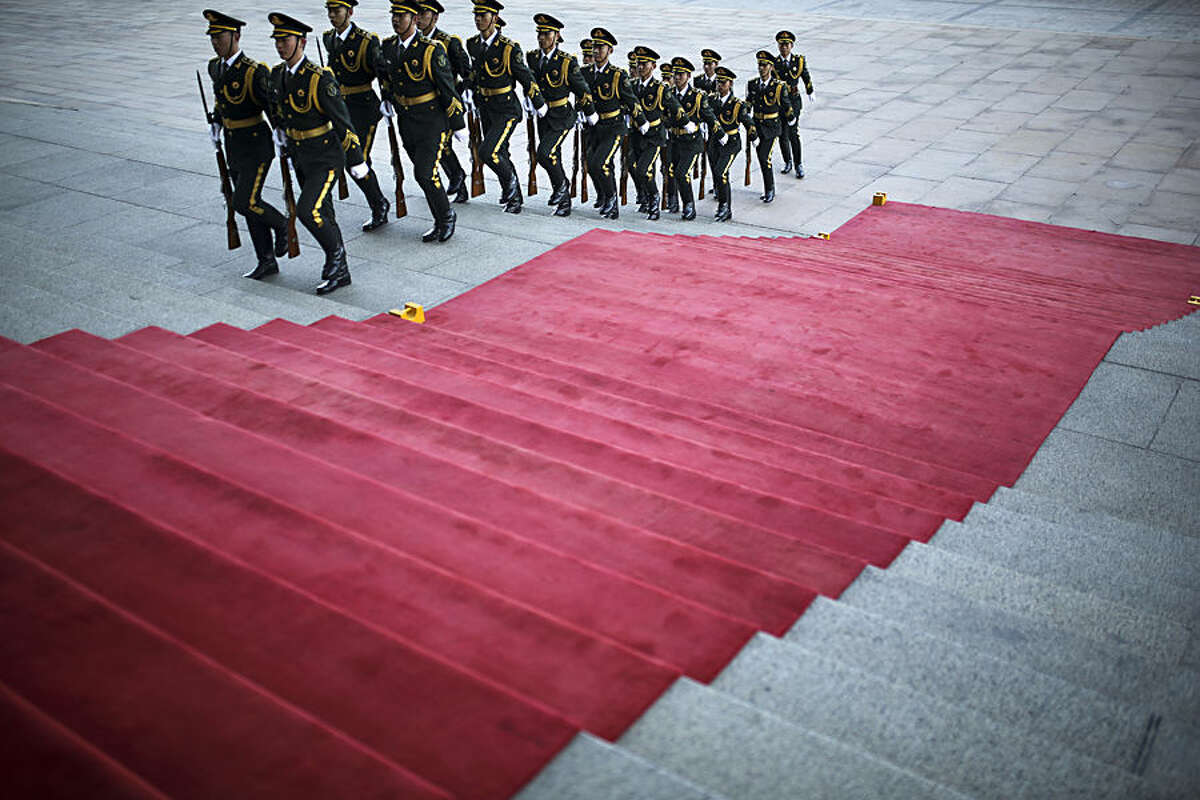 Chinese guards of honor march near the red carpet placed at the main entrance of the Great Hall of the People as they prepare for a welcome ceremony held by Chinese President Xi Jinping for visiting Mexican President Enrique Pena Nieto, in Beijing, China Thursday, Nov. 13, 2014. (AP Photo/Andy Wong)