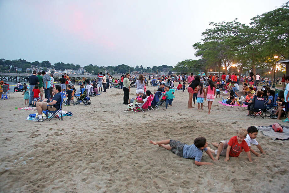 A crowded beach before the annual Stamford fireworks display at Cummings Park Thursday evening.