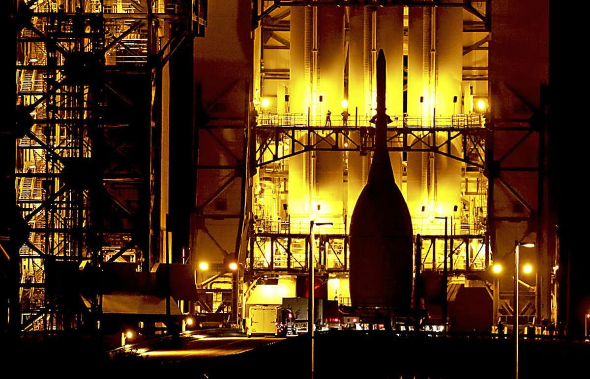After a 22-mile journey from the Launch Abort System Facility at the Kennedy Space Center, the Orion Spacecraft arrives at Space Launch Complex 37B at the Cape Canaveral Air Force Station, Wednesday, Nov. 12, 2014, in Cape Canaveral, Fla. The test flight for Orion is scheduled to launch on Dec. 4. (AP Photo/John Raoux)