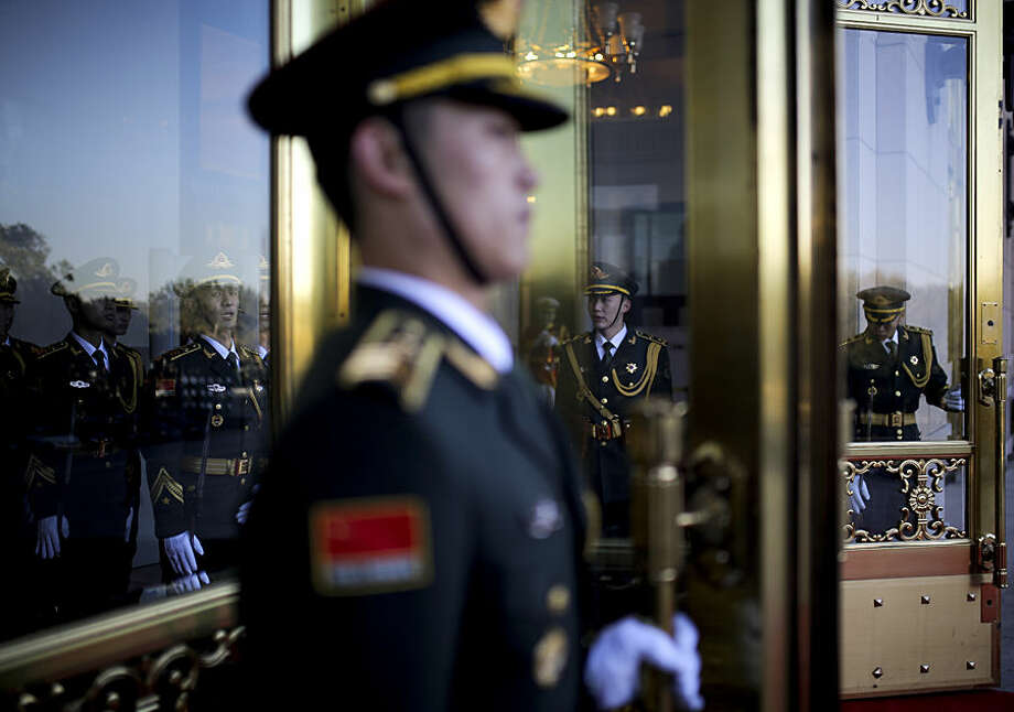 Chinese guards of honor prepare at the main entrance of the Great Hall of the People for a welcome ceremony held by Chinese President Xi Jinping for visiting Mexican President Enrique Pena Nieto, in Beijing, China Thursday, Nov. 13, 2014. (AP Photo/Andy Wong)