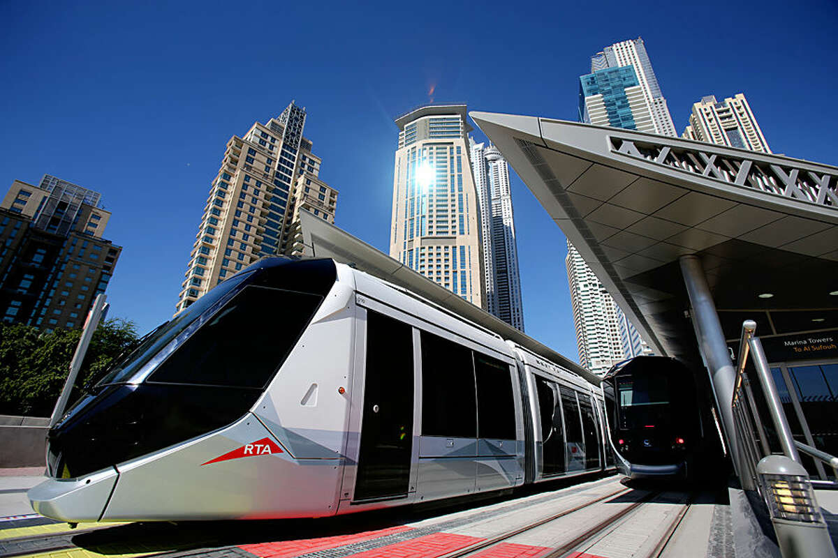 A tram leaves Marina Towers station during the first day of operation in Dubai, United Arab Emirates, Wednesday, Nov. 12, 2014. The Mideast commercial hub of Dubai opened its first tram line on Wednesday, enticing would-be riders with air-conditioned platforms and a premium section on its sleek cars for those willing to spend a few more dirhams. (AP Photo/Kamran Jebreili)