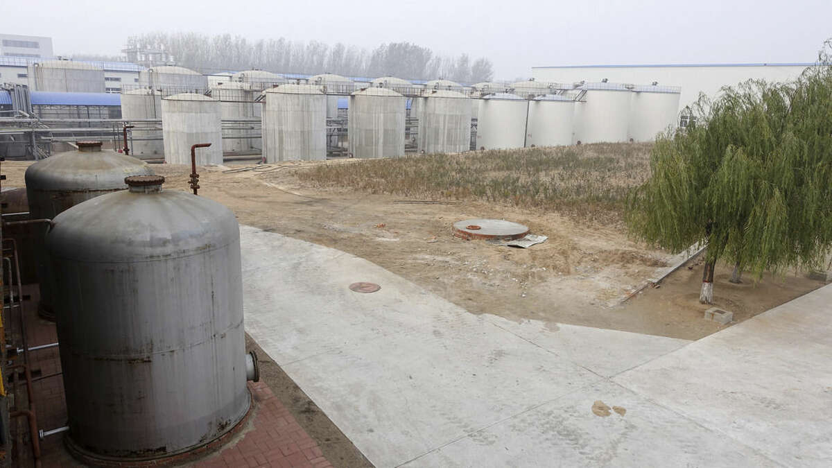 In this photo taken Oct. 24, 2014, Tianhe's sprawling Jinzhou plant set amid cornfields about an hour northeast of Jinzhou town in China. Tianhe Chemicals Group Ltd. boasted rock-bottom labor costs, unique manufacturing techniques and net profit margins triple those of competitors such as DuPont Co. and 3M Co. (AP Photo/Erika Kinetz)