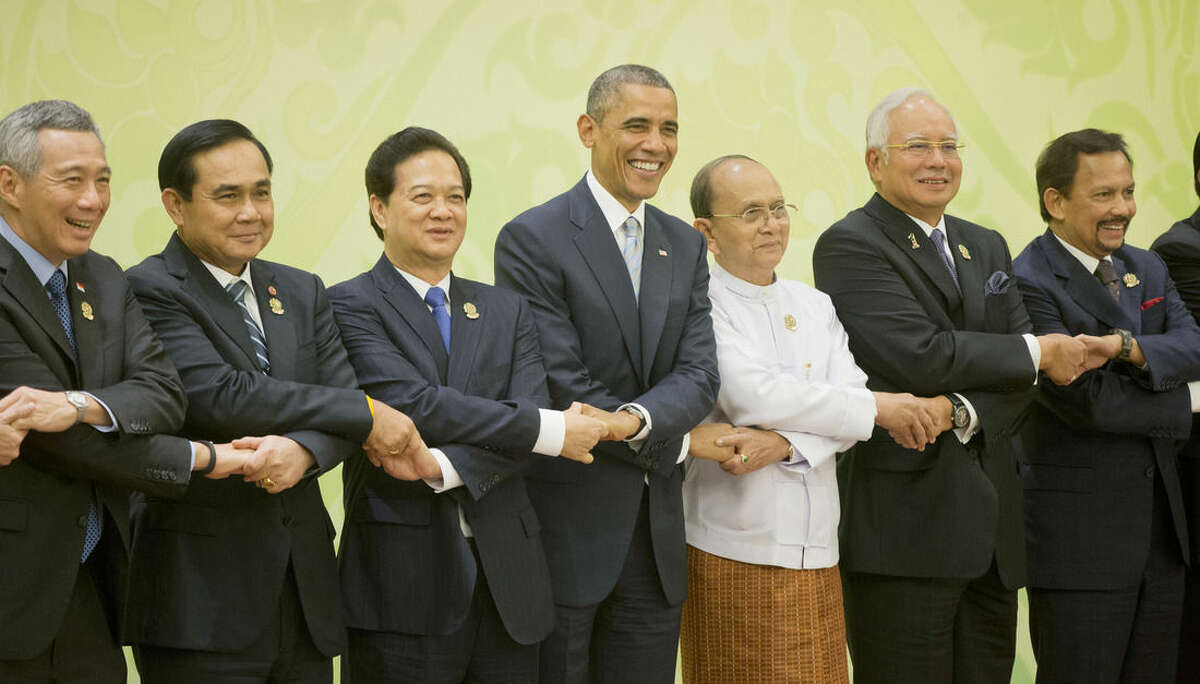 AP Photo/Pablo Martinez Monsivais U.S. President Barack Obama, center, shakes hands at the U.S.-ASEAN (Association of South East Asian Nations) meeting at the Myanmar International Convention Center, Thursday, Nov. 13, in Naypyitaw, Myanmar. With Obama are from left to right: Singaporean Prime Minister Lee Hsien Loong, Thailand Prime Minister Gen. Prayuth Chan-ocha; Vietnam Prime Minister Nguyen Tan Dung; Myanmar President Thein Sein; Malaysian Prime Minister Najib Razak; and Sultan of Brunei Hassanal Bolkiah.
