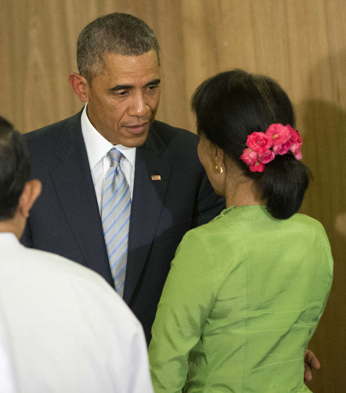 U.S. President Barack Obama, left, stops to talk with Myanmar's opposition leader Aung San Suu Kyi, right, following his meeting at the Roundtable at the Parliamentary Center, Thursday, Nov. 13, 2014 in Naypyitaw, Myanmar. (AP Photo/Pablo Martinez Monsivais)