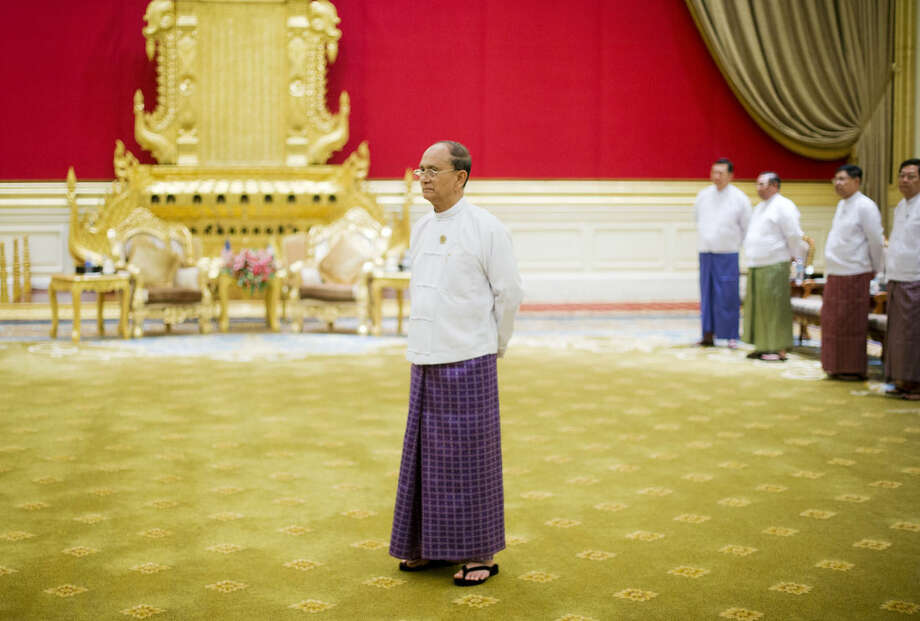 Myanmar's President Thein Sein waits to greet President Barack Obama before the start of their meeting at the Presidential Palace in Naypyitaw, Myanmar, Thursday, Nov. 13, 2014. (AP Photo/Pablo Martinez Monsivais)