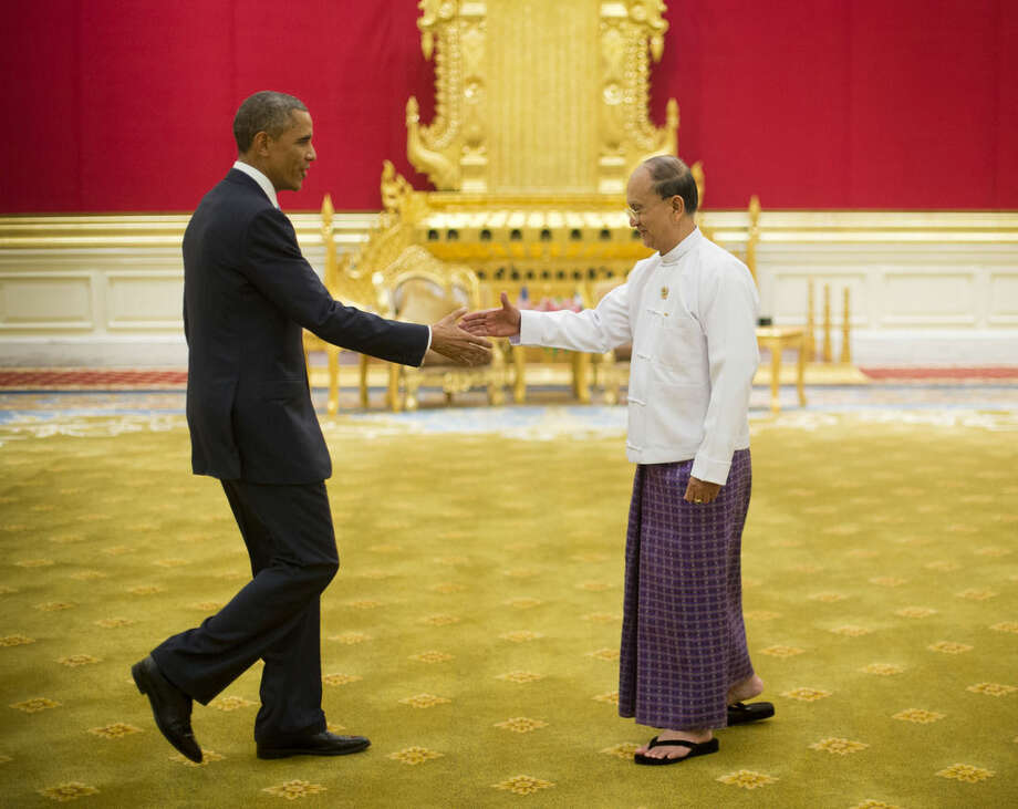 President Barack Obama reaches to shakes hands with Myanmar's President Thein Sein, Thursday, Nov. 13, 2014, at the Presidential Palace in Naypyitaw, Myanmar. (AP Photo/Pablo Martinez Monsivais)