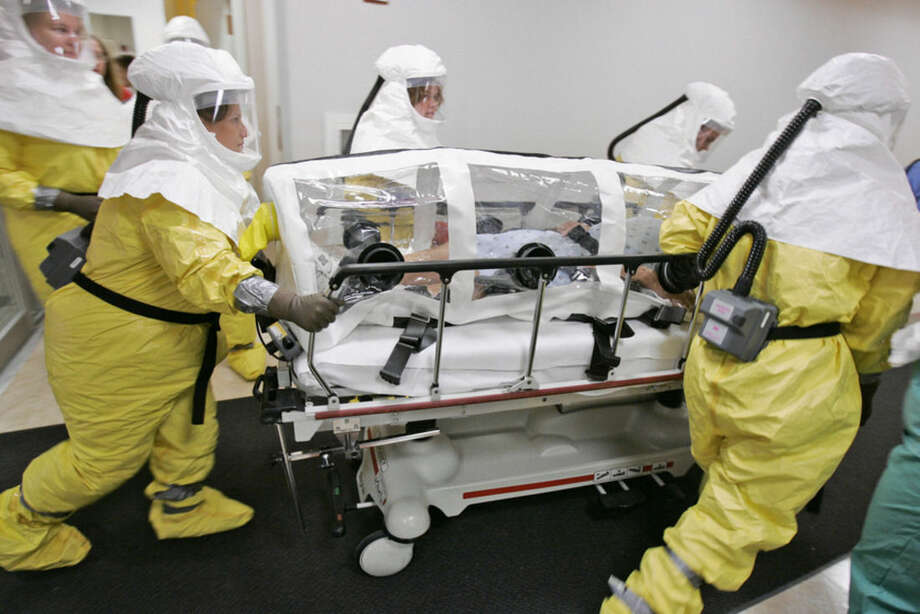 FILE - In this Oct. 28, 2006, file photo, a mock patient is wheeled in an isolation pod during a drill at the Nebraska biocontainment unit in the Nebraska Medical Center in Omaha, Neb. A federal government source said Thursday, Nov. 13, 2014, a surgeon working in West Africa's Sierra Leone has been diagnosed with Ebola and will be flown to the United States for treatment on Saturday, Nov. 15, 2014. The doctor will be treated at the Nebraska Medical Center in Omaha. (AP Photo/Nati Harnik, File)