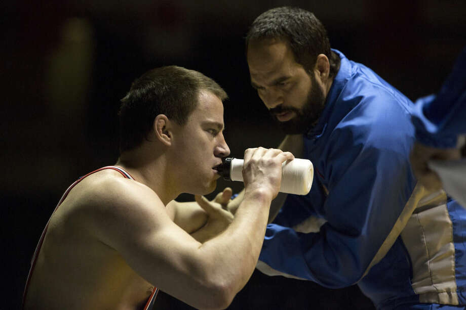 "This image released by Sony Pictures Classics shows Channing Tatum, left, and Mark Ruffalo in a scene from ""Foxcatcher."" (AP Photo/Sony Pictures Classics, Scott Garfield)"