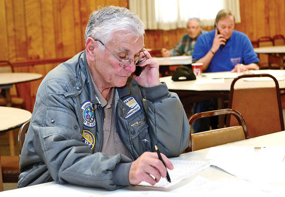 Hour photo / Erik Trautmann Volunteers including army veteran from Post 141, George Areson, man the phones as the Frank C. Godfrey American Legion Post 12 hosts a 3rd District Post Membership Revitalization Program on Thursday. Post members from across the State will be on hand to contact prospective and new veterans to join or transfer into the local Posts. The event continues through the Saturday, November 15th from 10:00 AM to 4:30 PM each day.