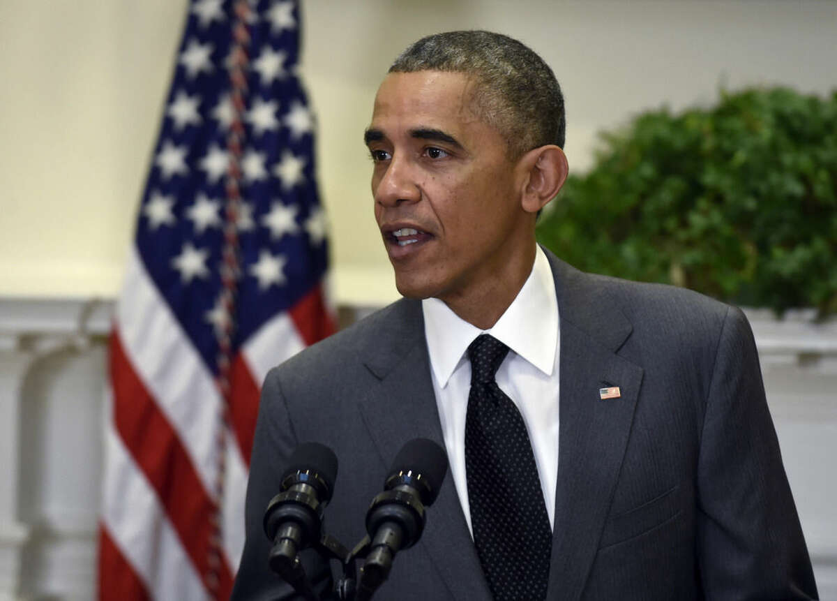 President Barack Obama comments on the prisoner release from North Korea following an announcement for U.S. Attorney Loretta Lynch to be the next Attorney General, Saturday, Nov. 8, 2014, in the Roosevelt Room of the White House in Washington. The president said he is