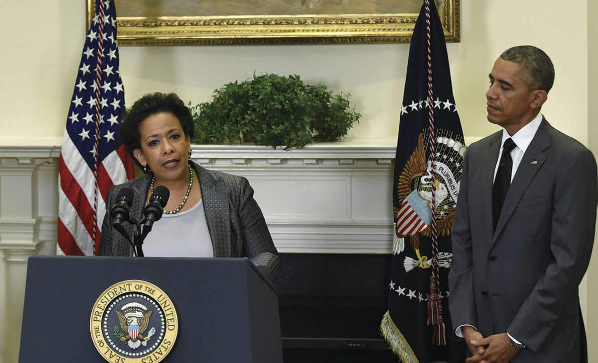 AP Photo/Susan Walsh President Barack Obama listens as U.S. Attorney Loretta Lynch speaks after Obama nominated Lynch to be the Attorney General Saturday, in the Roosevelt Room of the White House in Washington. Lynch would succeed Attorney General Eric Holder.