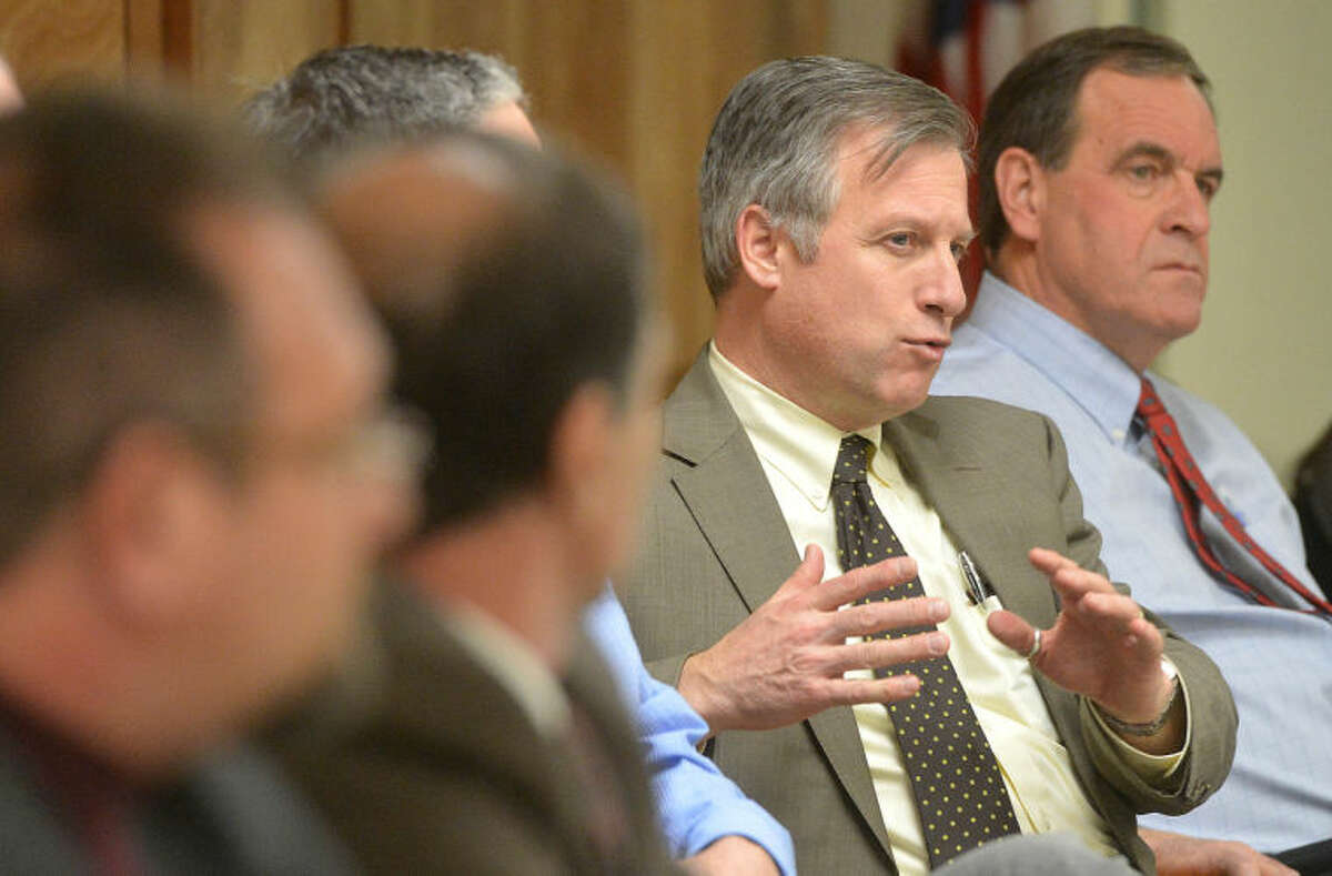 Hour Photo/Alex von Kleydorff. In this file photo, the City of Norwalk's Director of Finance Thomas Hamilton talks about property taxes and assesment appeals during Mayors Night Out at the East Norwalk Library on Wednesday night.
