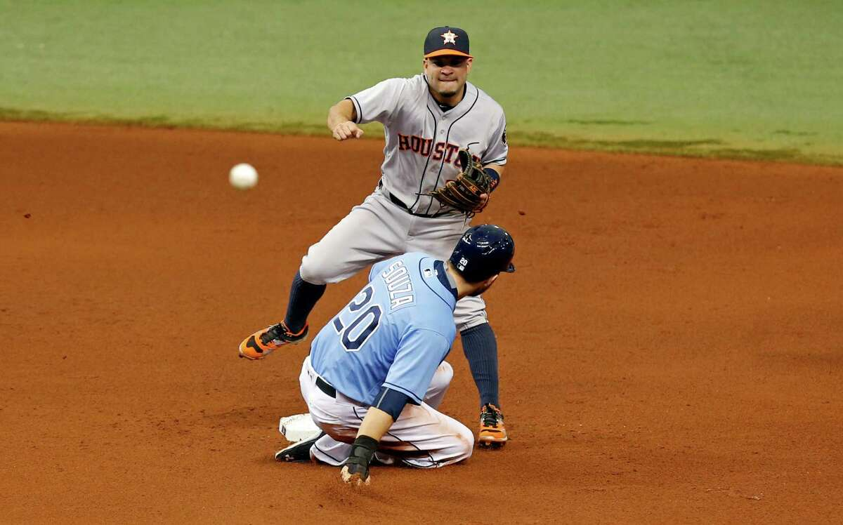 ST. PETERSBURG, FL - JUNE 12: Jose Altuve #27 of the Houston Astros throws over Steven Souza Jr. #20 of the Tampa Bay Rays during the fifth inning of a game at Tropicana Field on June 12, 2016 in St. Petersburg, Florida.
