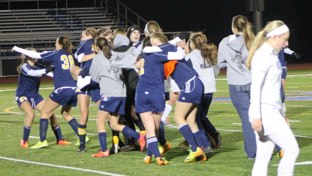 The Weston girls soccer team celebrates its 2-0 win over Waterford.