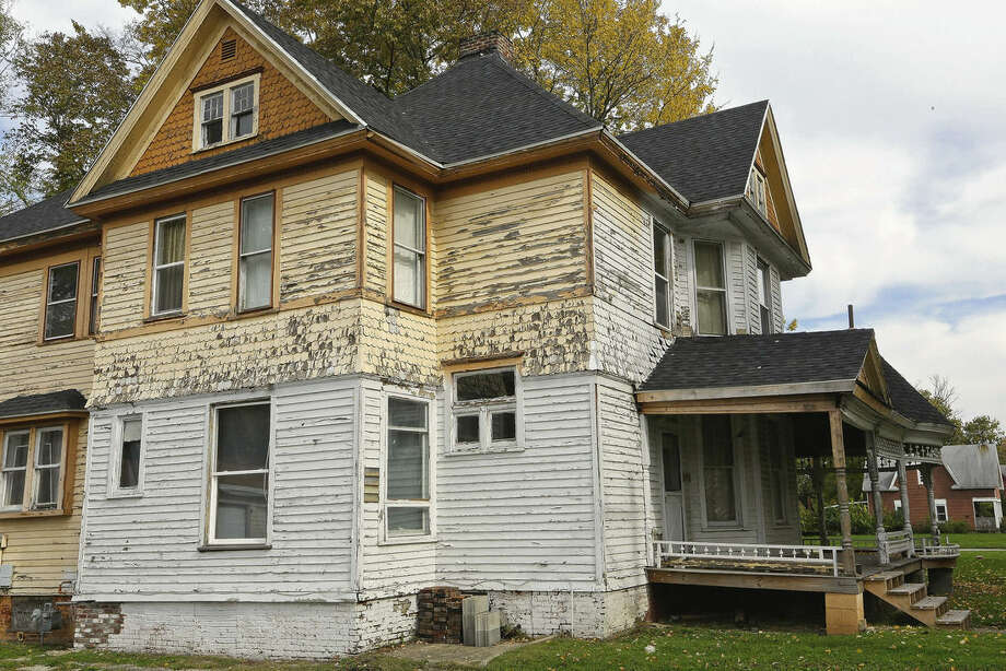 In this Oct. 23, 2014 photo, an abandoned home is one of thousands in Danville, Ill., a city that has struggled as manufacturers that provided thousands of well-paying, middle class jobs have closed. . Many young people have moved away. but the city is working to attract businesses and give residents a reason to stay. (AP Photo/Seth Perlman)