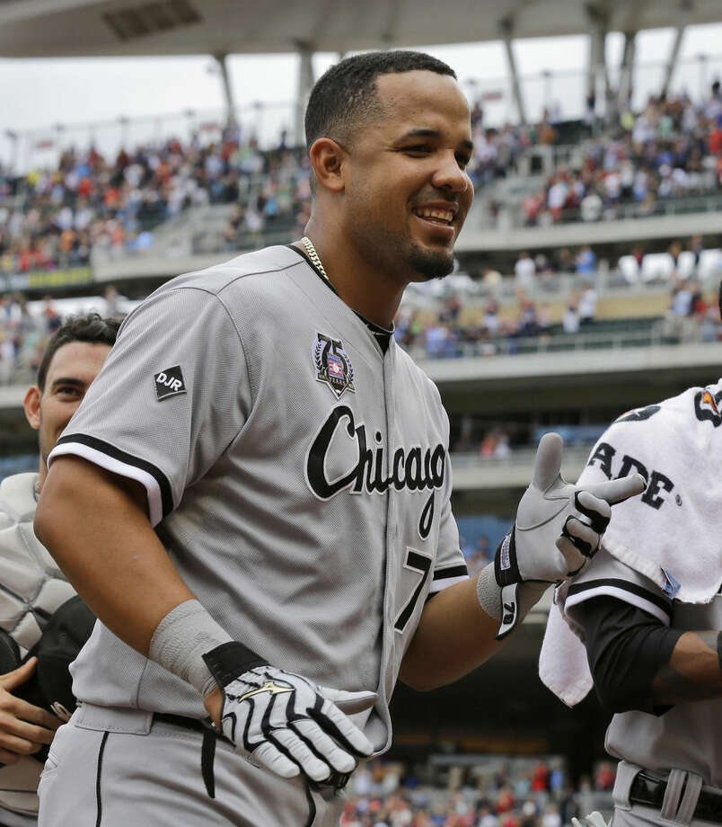 FILE - This July 27, 2014, file photo shows Chicago White Sox first baseman Jose Abreu walking to the dugout before the start of a baseball game against the Minnesota Twins in Minneapolis. Abreu was a unanimous winner of the AL Rookie of the Year award, Monday Nov. 10, 2014. (AP Photo/Ann Heisenfelt, File)