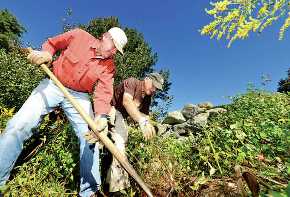Approximately 20 volunteers including Rick Koleszar and Alex Rochefort assist Weir Farm staff in removing invasive plants around the farm as part of the 20th annual National Public Lands Day. The day is the nation's largest, single-day volunteer cleanup of public lands.